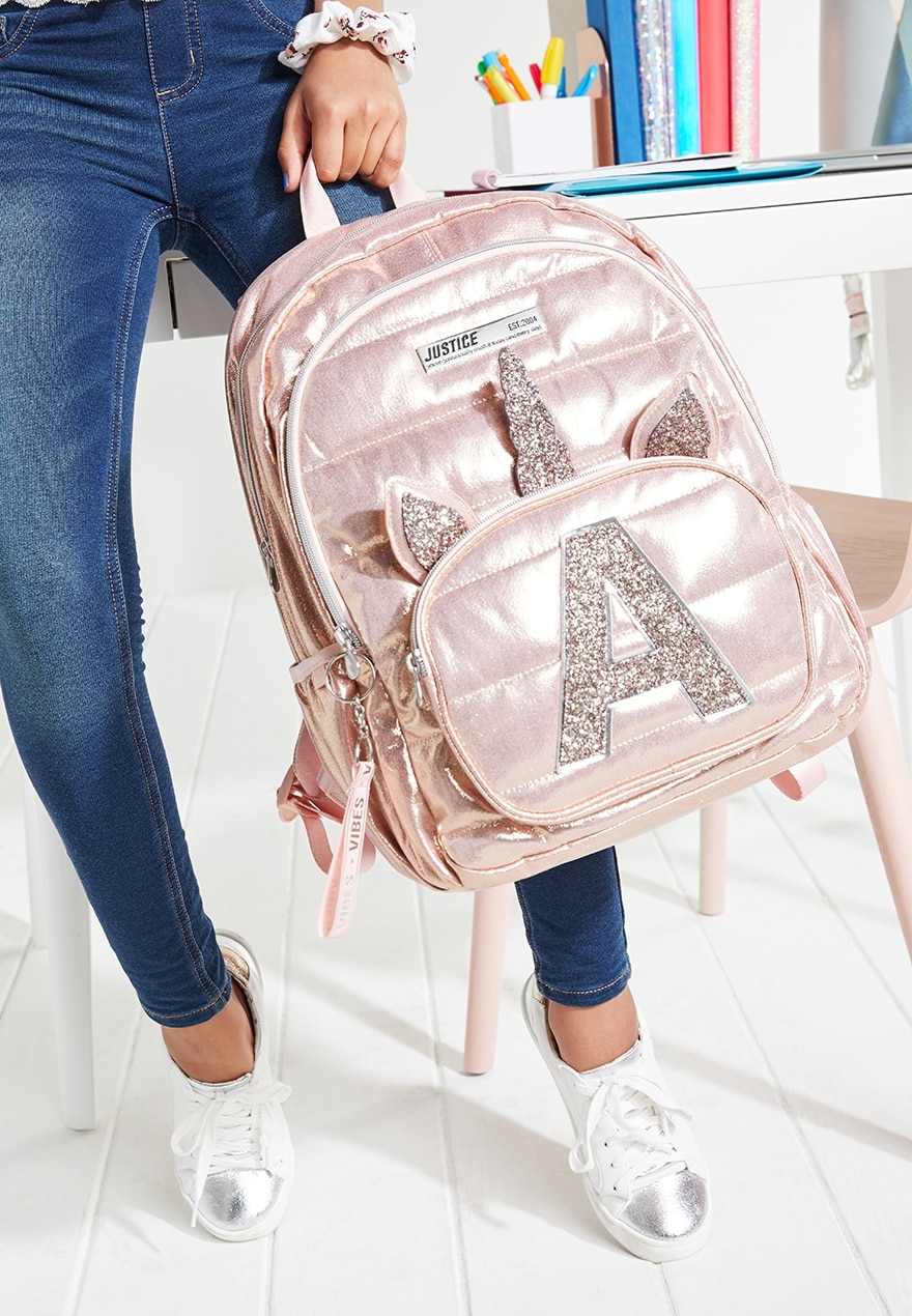 KWD19.5 / QR240 / AED250 / BD26 / JD57 / SAR280 / OMR24     Justice Rose Gold Quilted Unicorn Initial Backpack    16193344645